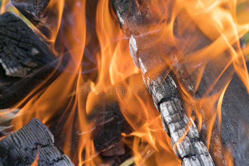 Fireplace burning. Warm cozy burning fire in a brick fireplace close up. Cozy background. Close up shot of burning firewood in the royalty free stock photography