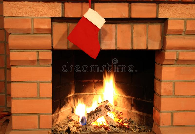 Fireplace with christmas sock stock photo
