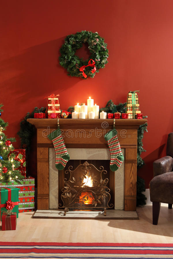 Fireplace decorated for Christmas stock photography