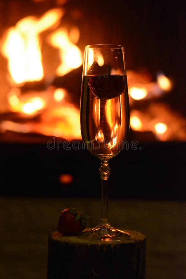 The fireplace with a glass of white wine royalty free stock image