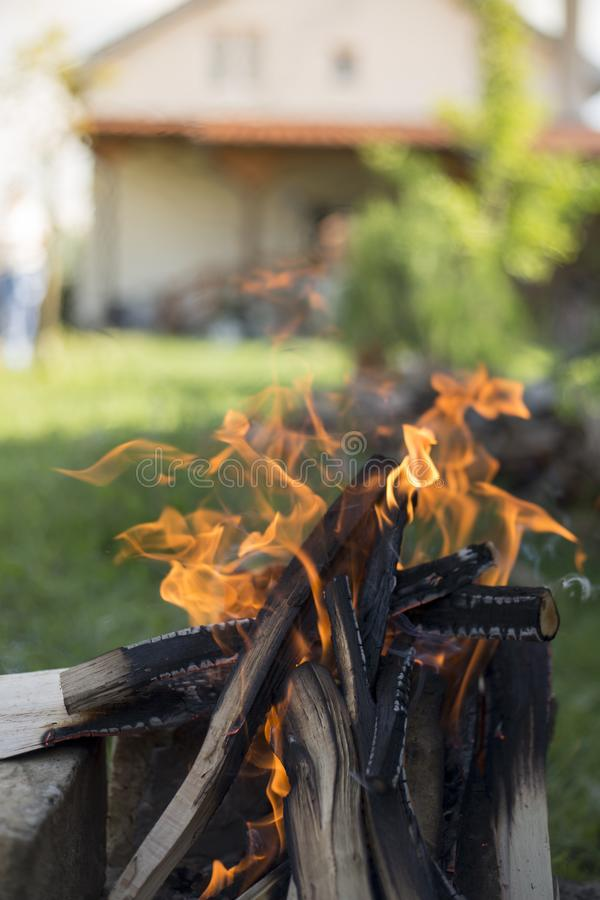 Fireplace by house barbecue starting fire royalty free stock image