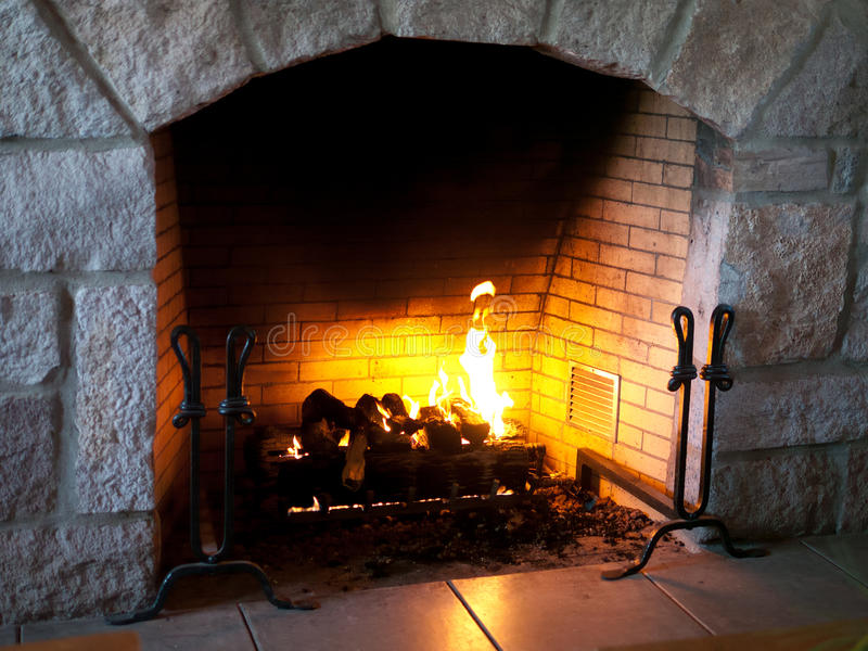 Fireplace at the lodge stock photography