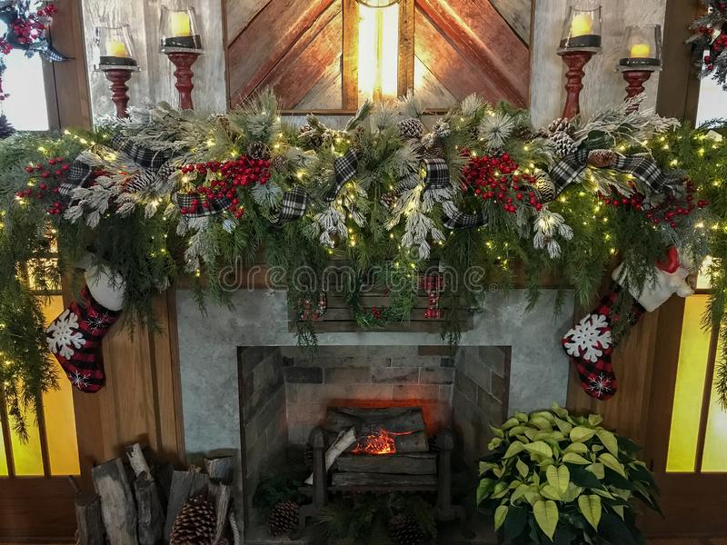 Cozy fireplace mantel Christmas evergreen. Fireplace mantel decor holidays stock images