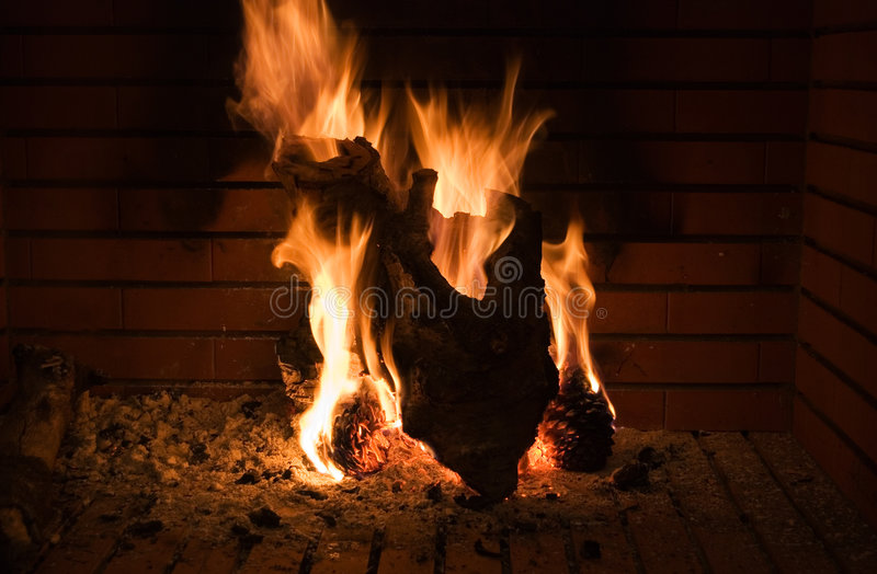 Fireplace shape of a hearth. Fireplace, wood with the shape of a hearth on fire royalty free stock image