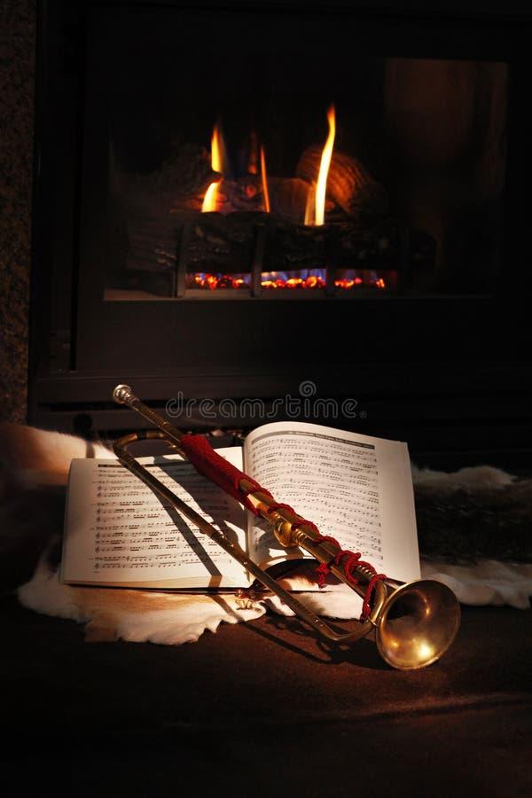 Fireplace, trumpet, music royalty free stock photo