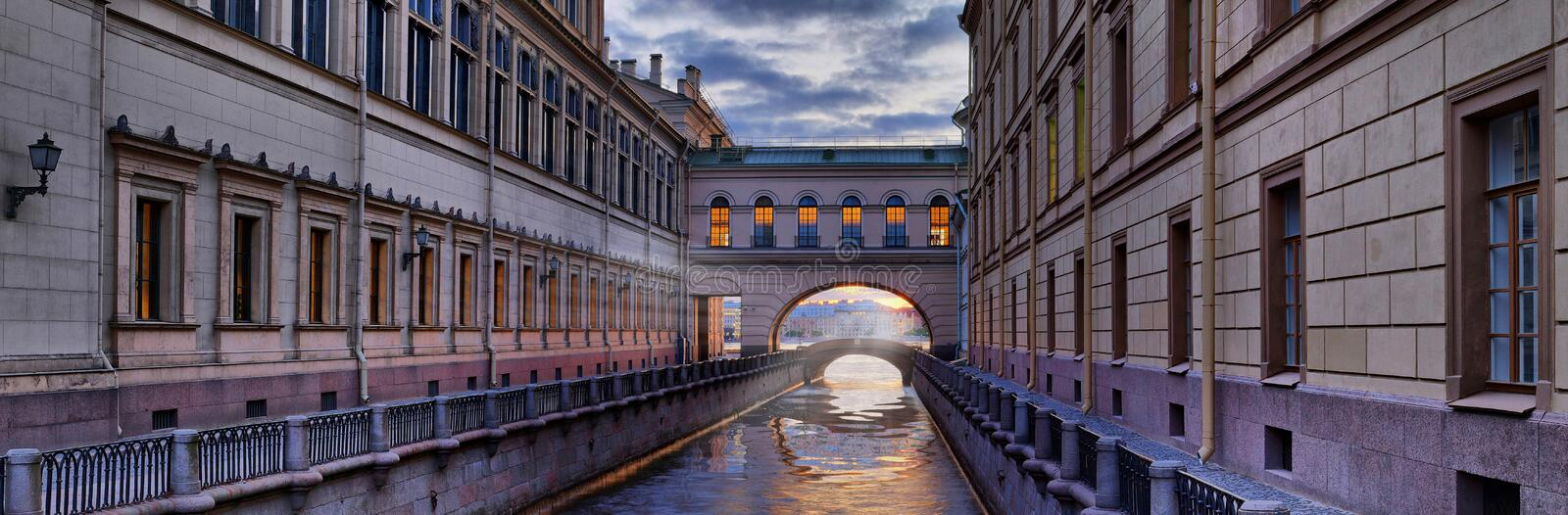 Fires of the Hermitage over the Winter Canal in St. Petersburg. Panorama of the Winter Canal and fires of the Hermitage in St. Petersburg stock photo