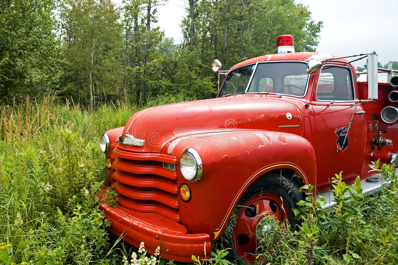 Firetruck antique - 1 images stock