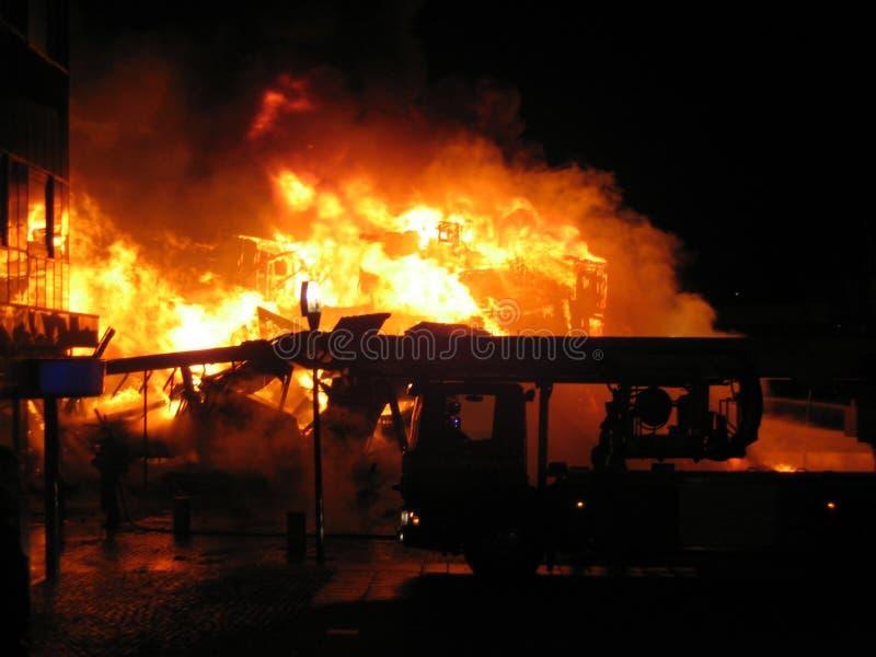 Firetruck infront of burning house stock photos
