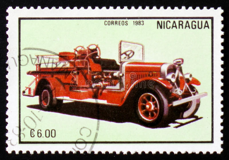 Firetruck, series, circa 1983. MOSCOW, RUSSIA - FEBRUARY 12, 2017: A stamp printed in Nicaragua shows firetruck, series, circa 1983 royalty free stock photography