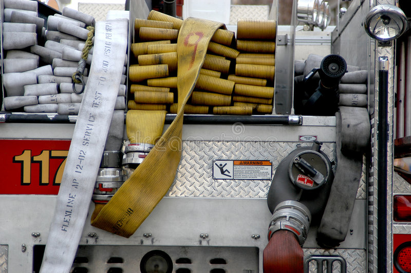Firetruck und Schlauch lizenzfreies stockbild