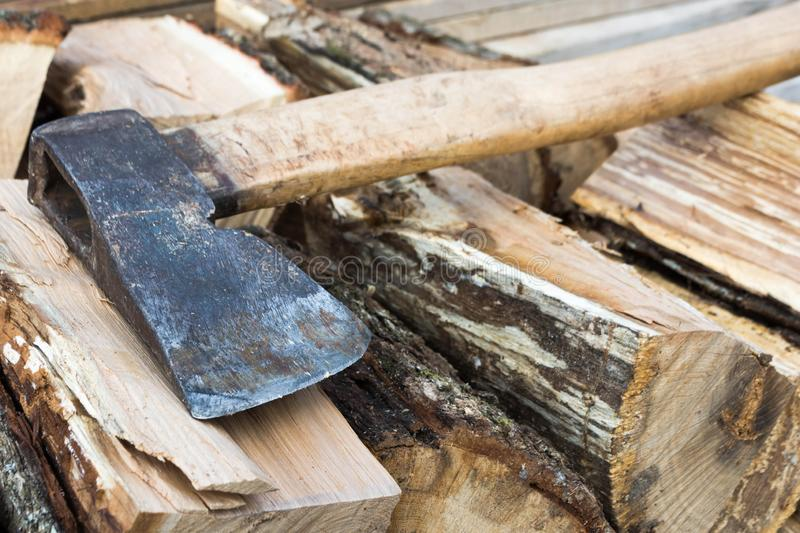 Firewood and ax. Ax cleaver and a lot of firewood, tree, forest, split, cut, fuel, work, industry, material, raw, heat, renewable, saw, forestry, cut-resistant royalty free stock photo