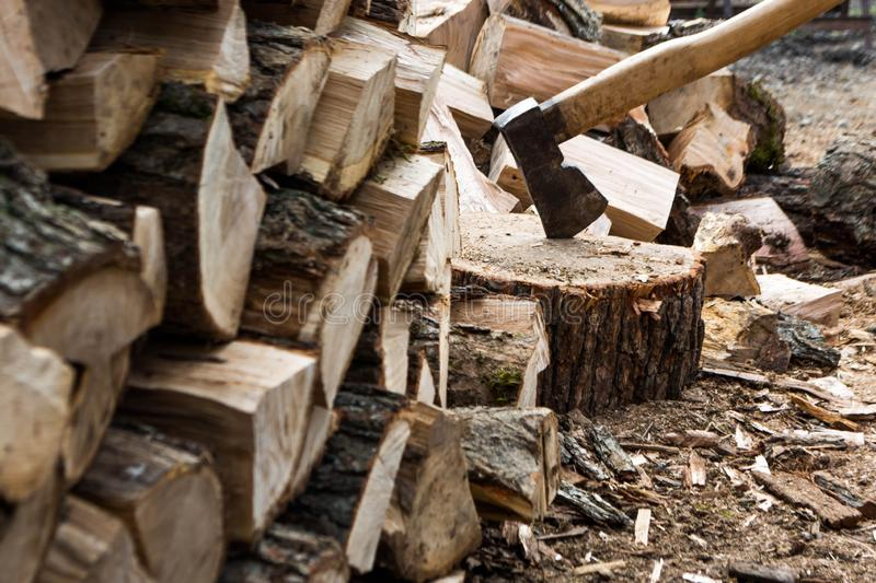 Firewood and ax. Ax cleaver and a lot of firewood, tree, forest, split, cut, fuel, work, industry, material, raw, heat, renewable, saw, forestry, cut-resistant royalty free stock photos