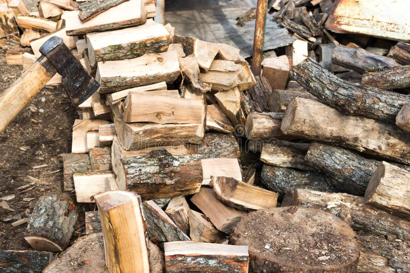 Firewood and ax. Ax cleaver and a lot of firewood, tree, forest, split, cut, fuel, work, industry, material, raw, heat, renewable, saw, forestry, cut-resistant stock images