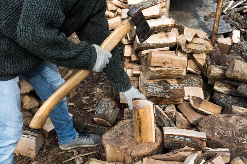 Firewood and ax. A man with an ax is whipping wood, tree, firewood, forest, split, cut, fuel, work, industry, material, raw, heat, renewable, saw, forestry, cut stock photography