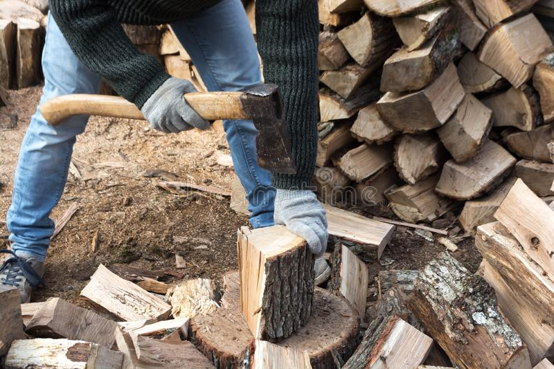 Firewood and ax. A man with an ax is whipping wood, tree, firewood, forest, split, cut, fuel, work, industry, material, raw, heat, renewable, saw, forestry, cut royalty free stock photo