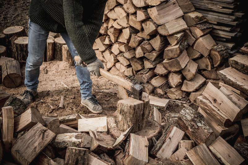 Firewood and ax. A man with an ax is whipping wood, tree, firewood, forest, split, cut, fuel, work, industry, material, raw, heat, renewable, saw, forestry, cut royalty free stock photography