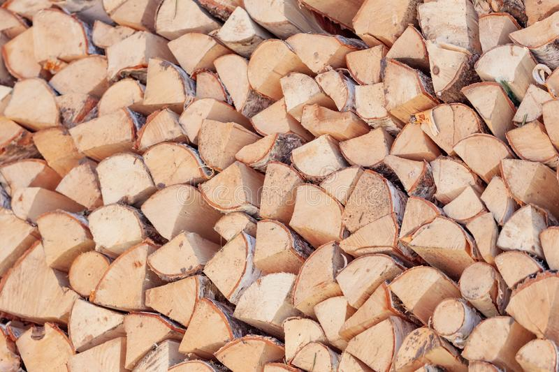 Firewood background, chopped firewood on a stack. Alternate energy stock photo
