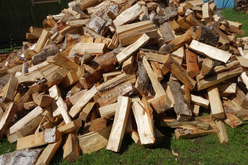 Firewood. Big pile. Firewood. A big pile on the green grassrn stock images