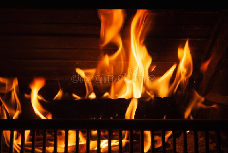 Fireplace with a bright flame, close-up stock photos
