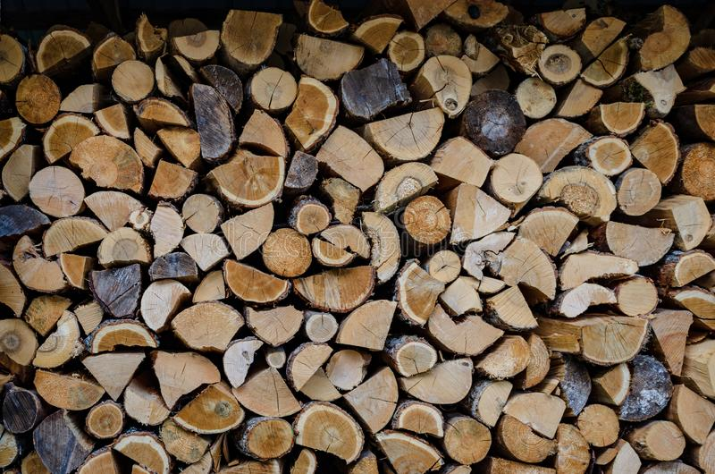 Firewood drying for the winter, stacks of firewood. stock photos