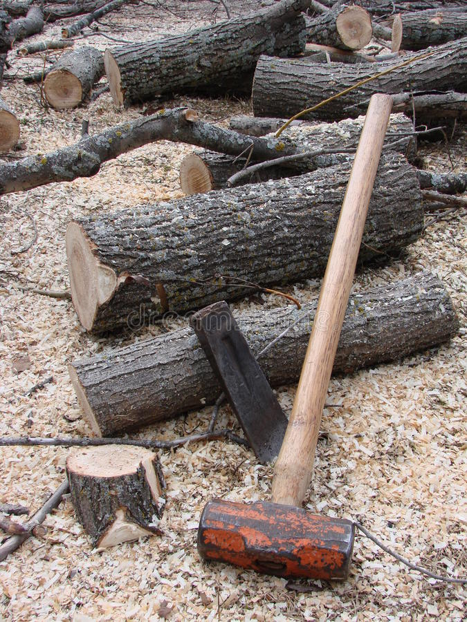Firewood and hand splitting tools royalty free stock image