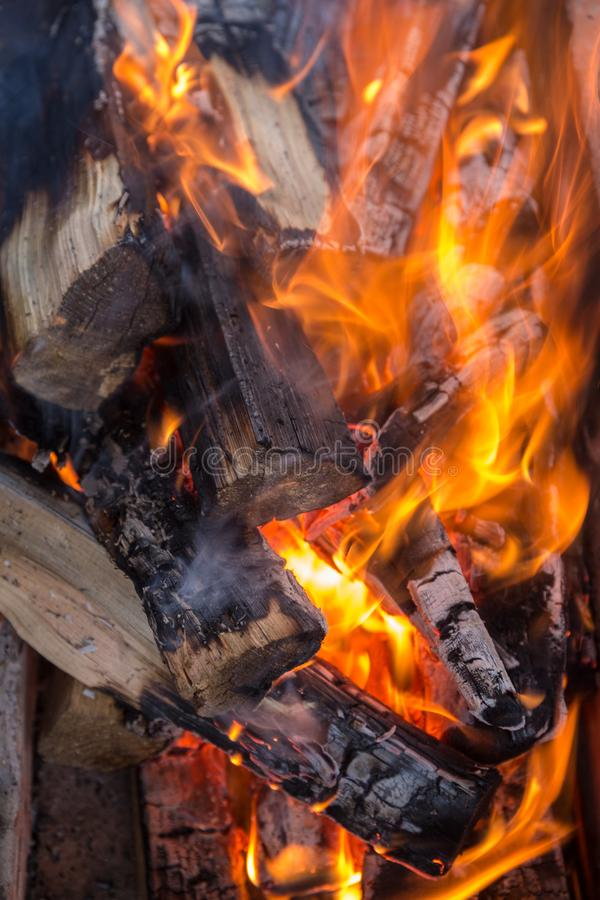 Firewood in the hearth. Burning firewood in the hearth close up royalty free stock image