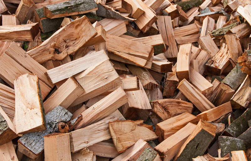 Firewood logs. Dry chopped firewood logs as an abstract background stock images