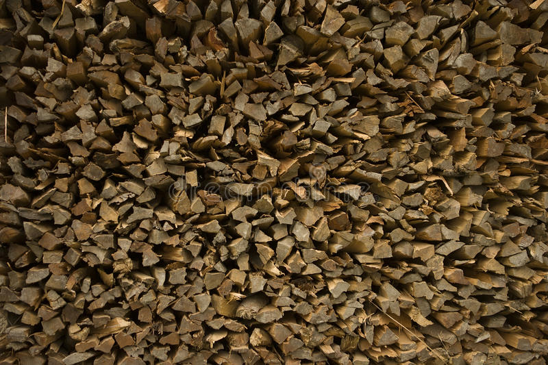 Firewood - pieces of teak wood, background royalty free stock photos