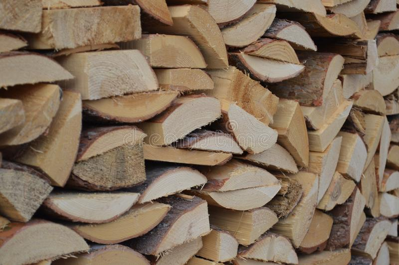 Firewood piled in a woodpile. Sawn wood log firewood to harvest to heat the stove and fireplace fuel stock photography