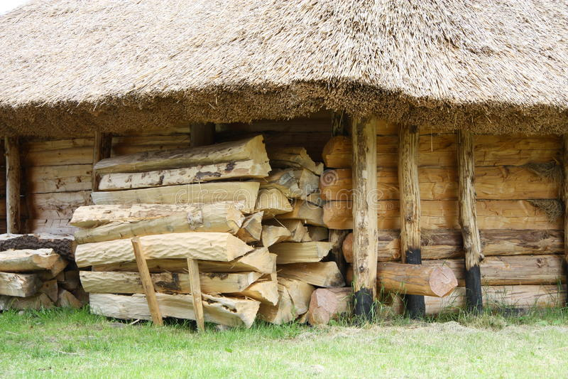 Firewood at Polish building. A view of a pile of firewood outside a building with a thatched roof in a Viking Village, Wolin, Poland royalty free stock photos