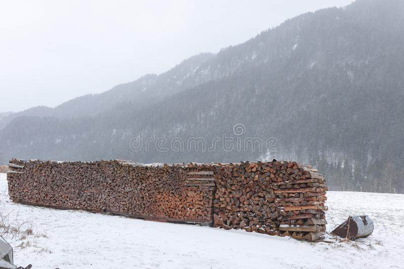 Firewood on a snowy meadow royalty free stock images