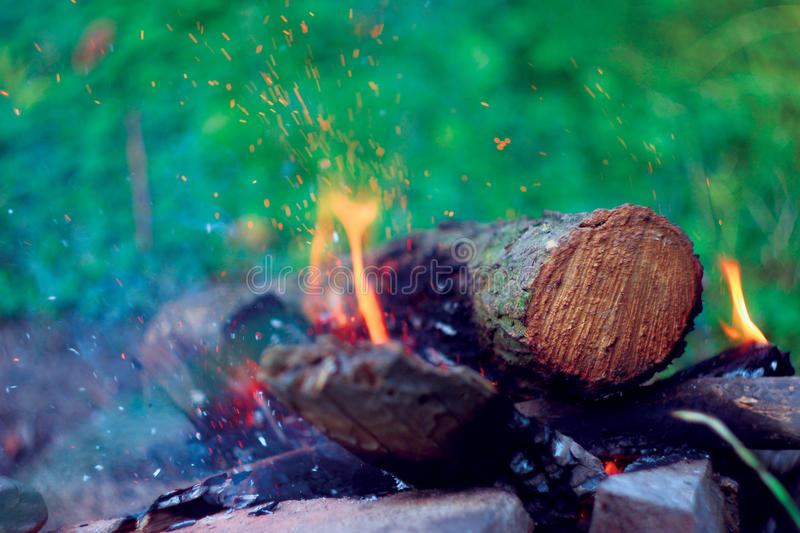 Firewood with sparks royalty free stock photography