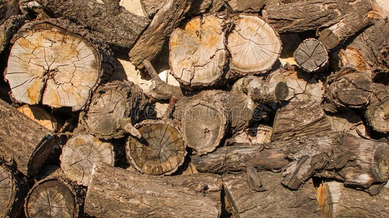 Firewood for winter, stacks of firewood, pile of firewood. Old sawn wood in backyard background royalty free stock photo