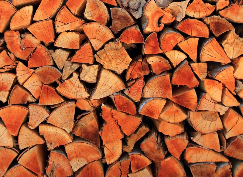 Firewood wood pile stacked triangle shape. Red color stock image