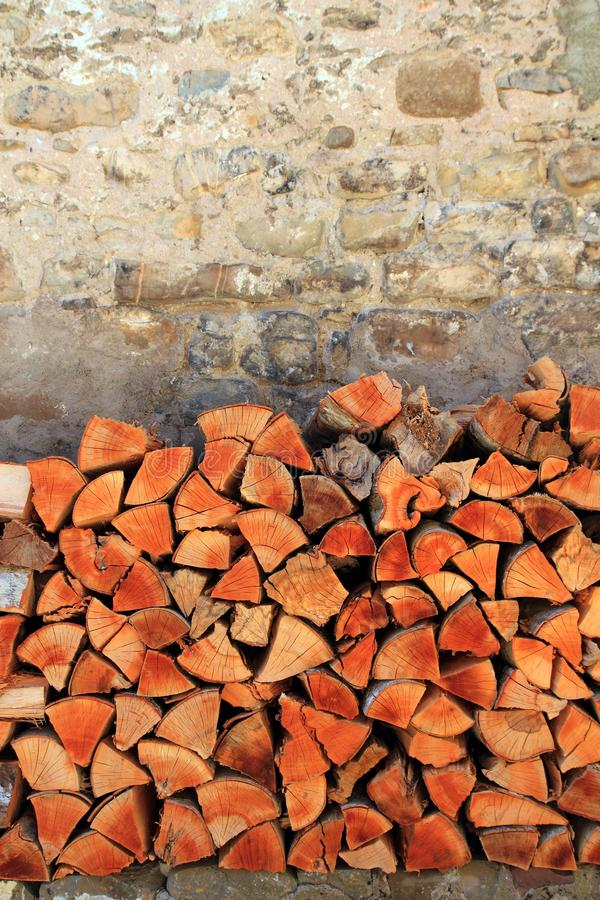 Firewood wood pile stacked triangle shape. Red color stock images