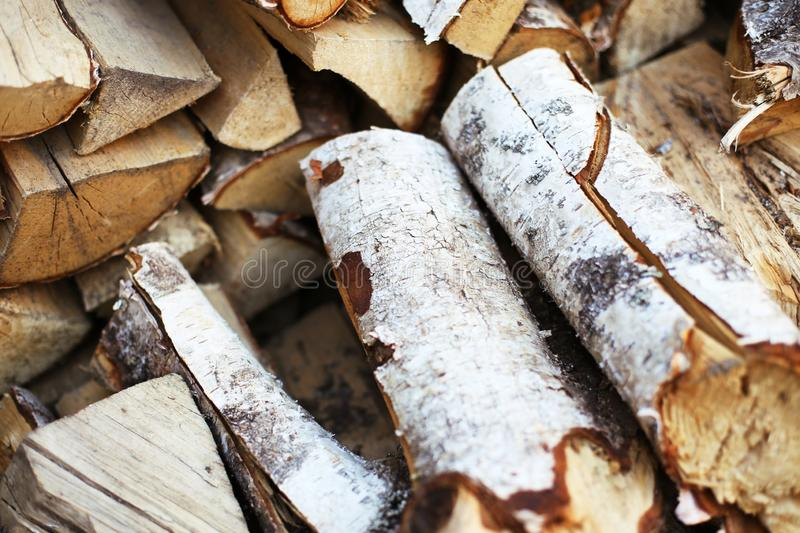 Firewood in the yard for winter holidays and cold season royalty free stock photography