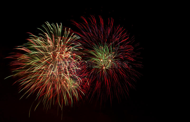 Firework. Multicolored firework on a black background with the copyspace for your text royalty free stock photos