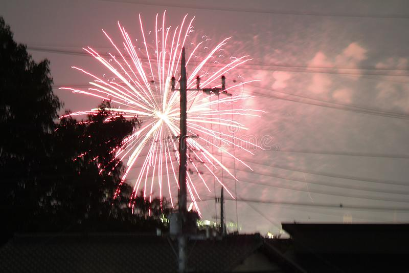 Firework above the roof at home. stock image