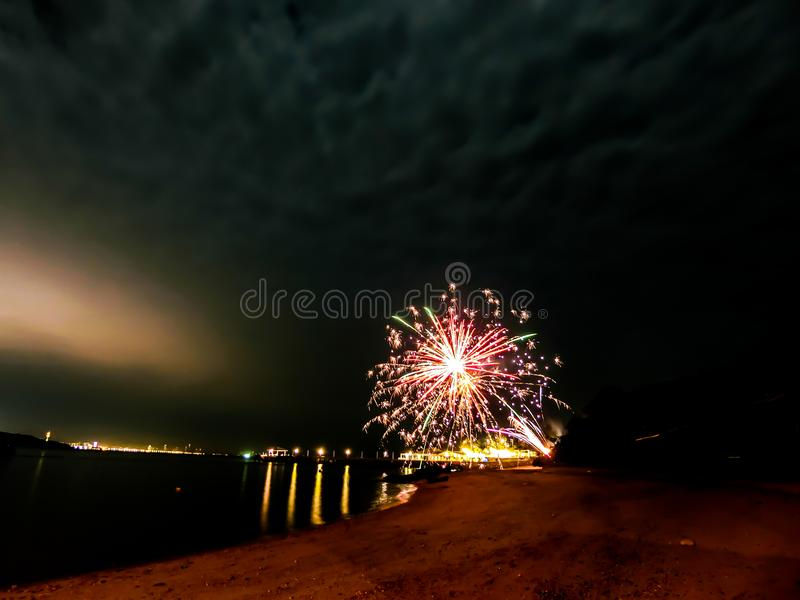 Firework at the beach in Pattaya city Thailand. In period of new year cerebration stock image