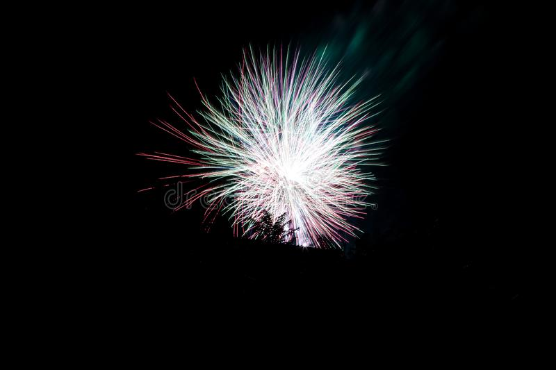 firework celebration, with a multiple long exposure to capture the movement of the explosion.black sky background royalty free stock image