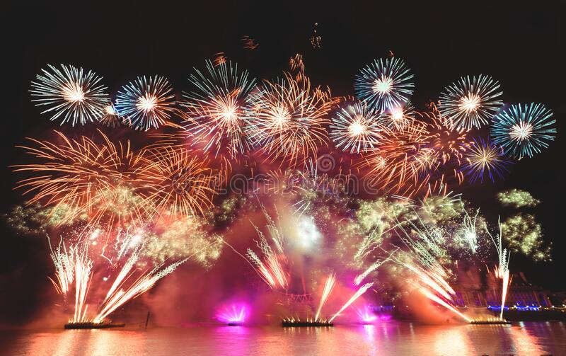 Firework display at night in london , low angle view royalty free stock image