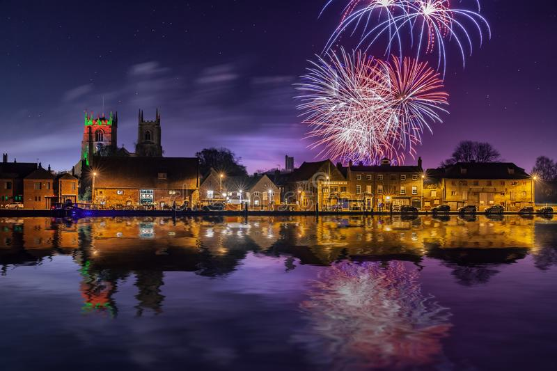 Firework display over town and river. Fireworks at Kings Lynn in Norfolk UK 2018. Rockets exploding in a display over the Great River Ouse at night time stock photos