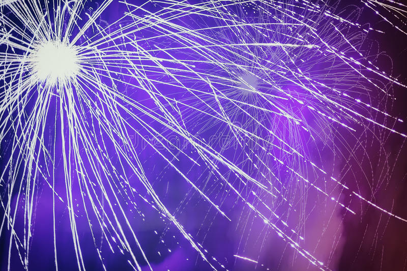 Firework with effects, noise, light and floating smoke close-up stock photo