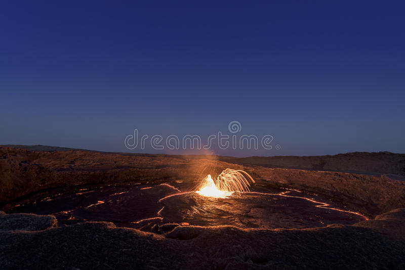 Firework on Erta Ale volcano. Lava fountain on the lava lake of the Erta Ale volcano giving a firework magical moment royalty free stock images