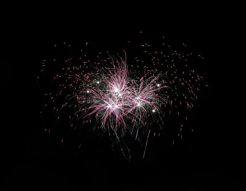 Firework. S, multicolor, celebration, night, long, longexposure, glowing, light, background, black, dark, sky, blurred royalty free stock image