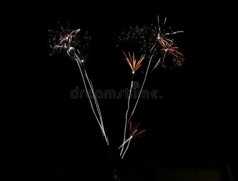 Firework. S, multicolor, celebration, night, long, longexposure, glowing, light, background, black, dark, sky, blurred royalty free stock photo