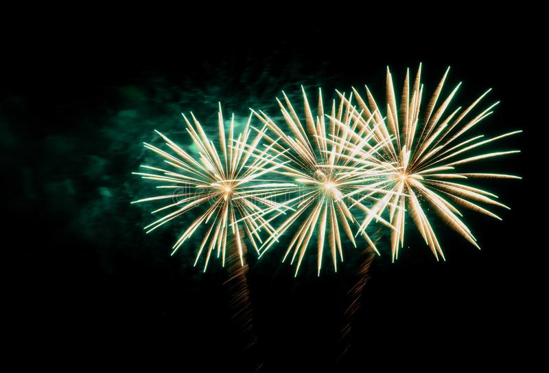 Firework with green smoke on a black background stock images
