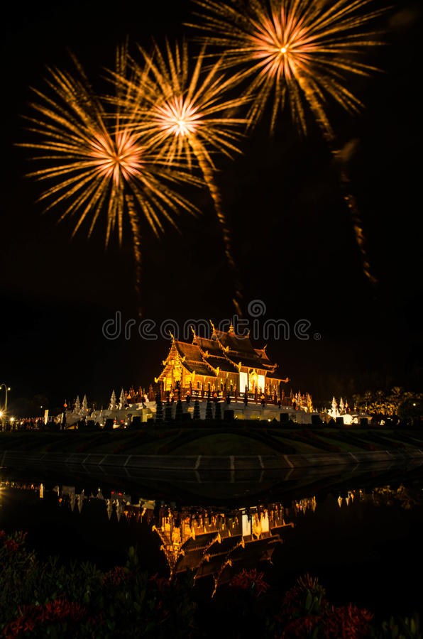 Firework Ho kham luang northern thai style building in Royal Flora temple ratchaphreukin Chiang Mai,Thailand.  royalty free stock photos