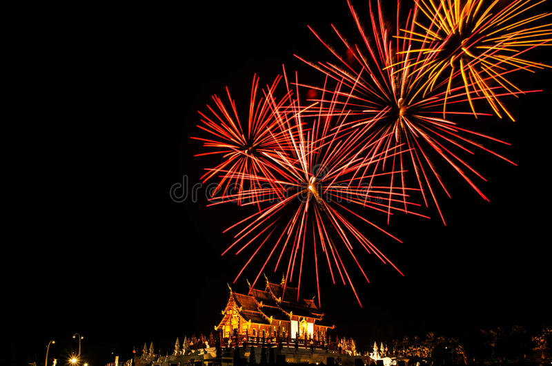 Firework Ho kham luang northern thai style building in Royal Flora temple ratchaphreukin Chiang Mai,Thailand.  stock photo