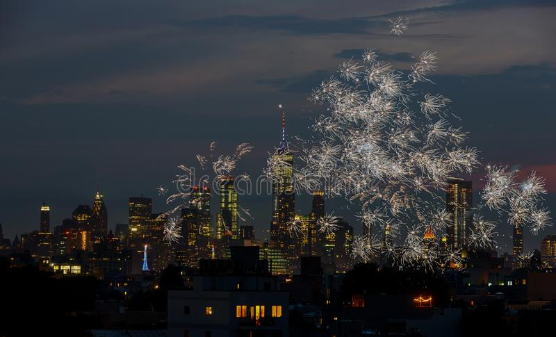 Firework over city at night with Fireworks over Manhattan royalty free stock photography
